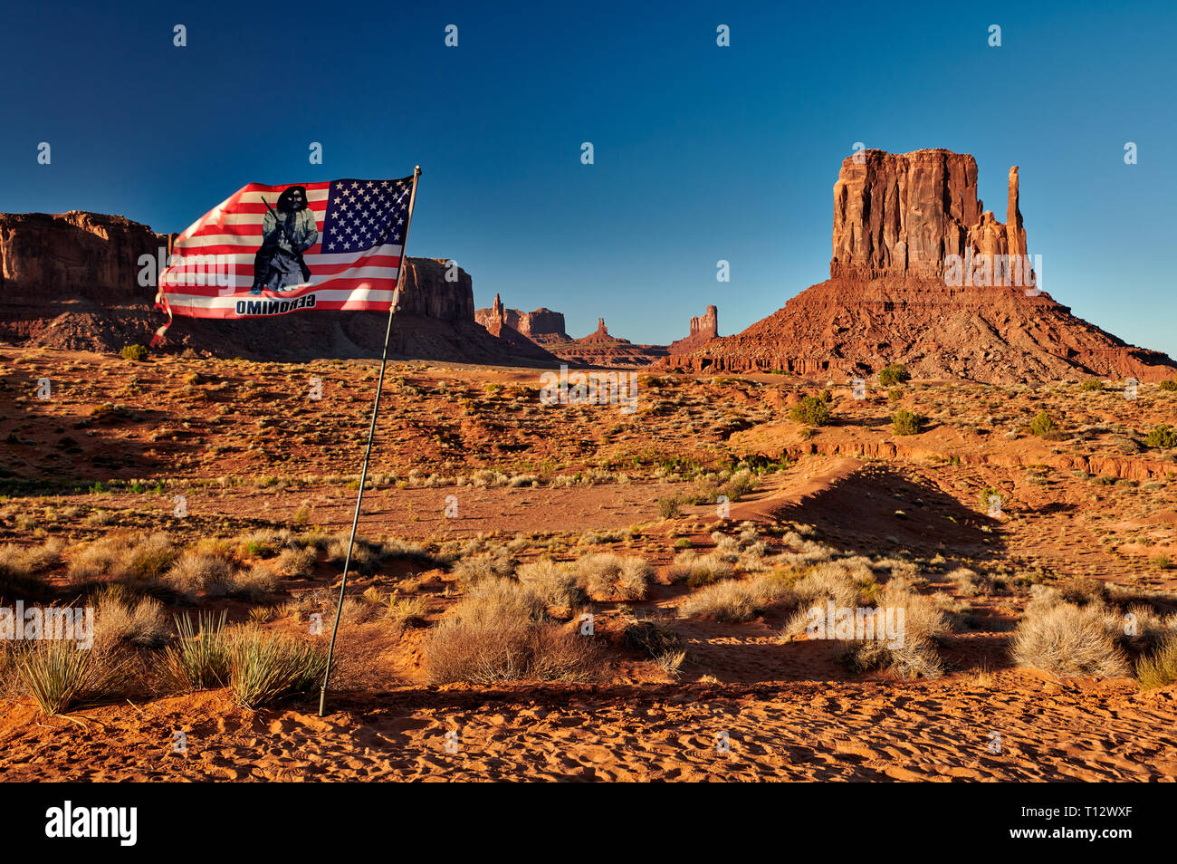 American flag withThe West Mitten Butte in Monument Valley, Arizona, USA, North America - Stock Image