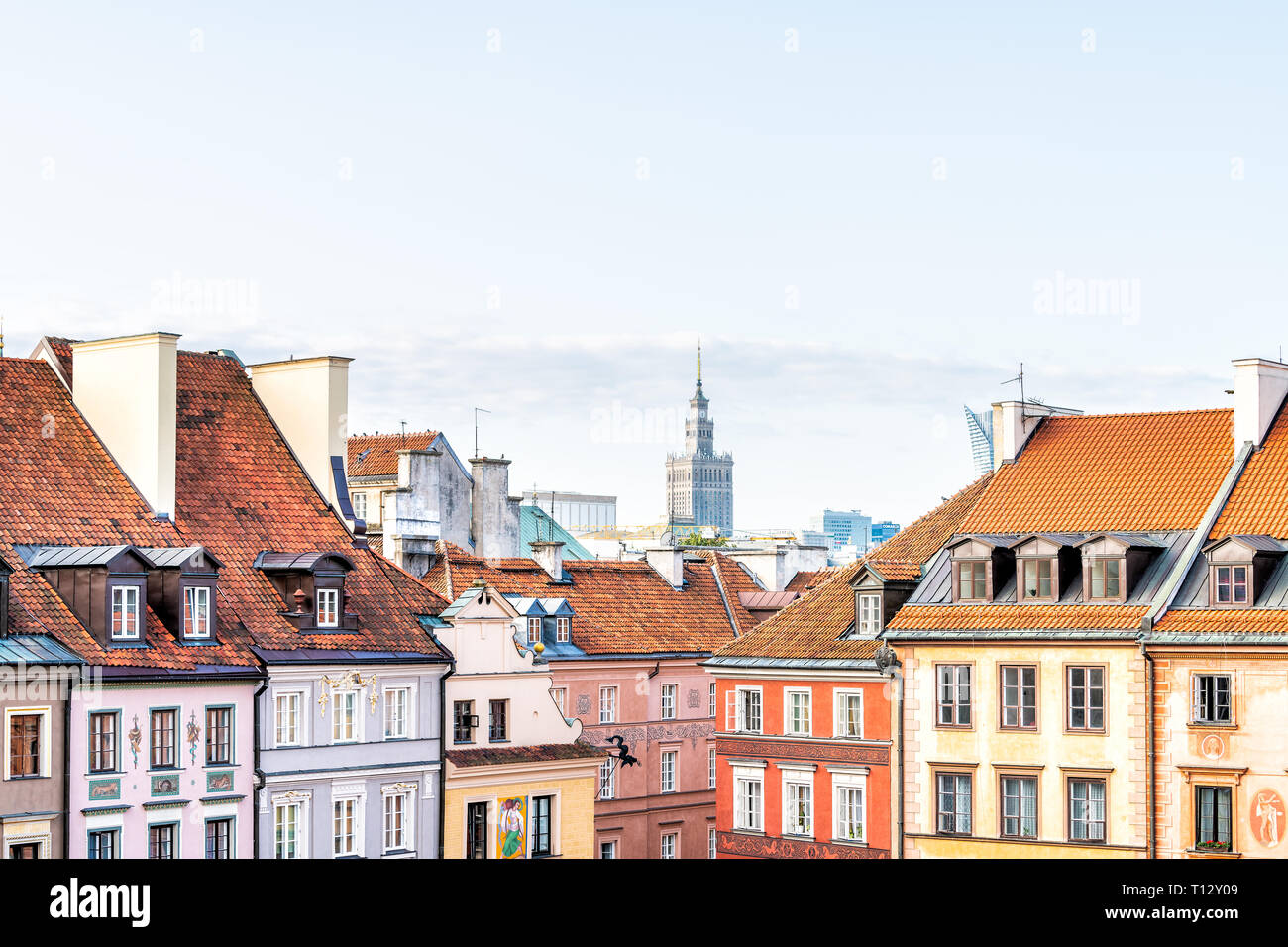 Warsaw, Poland - August 22, 2018: Downtown cityscape with Palace of Culture and Sciences building skyscraper and multicolored old town rooftop houses Stock Photo