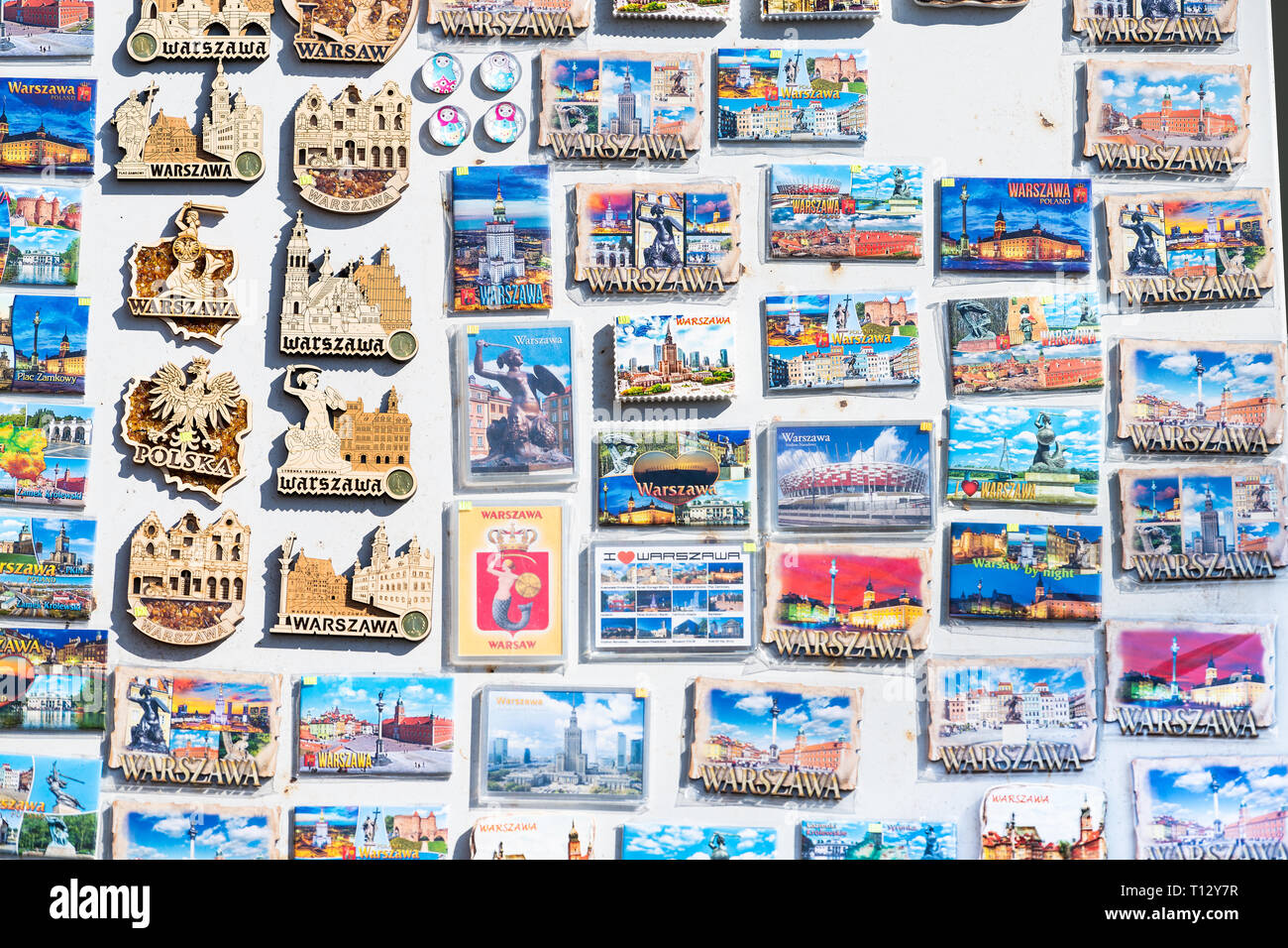 Warsaw, Poland - August 22, 2018: Many souvenirs colorful vibrant colors magnets for refrigerator on display in shopping street market Stock Photo
