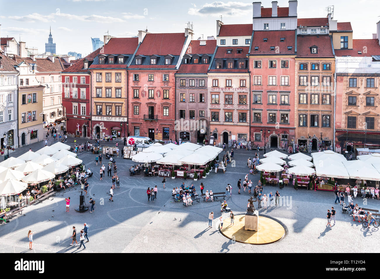 Warsaw, Poland - August 22, 2018: Cityscape with high angle view of architecture rooftop buildings and sky in old town market square in evening with m Stock Photo