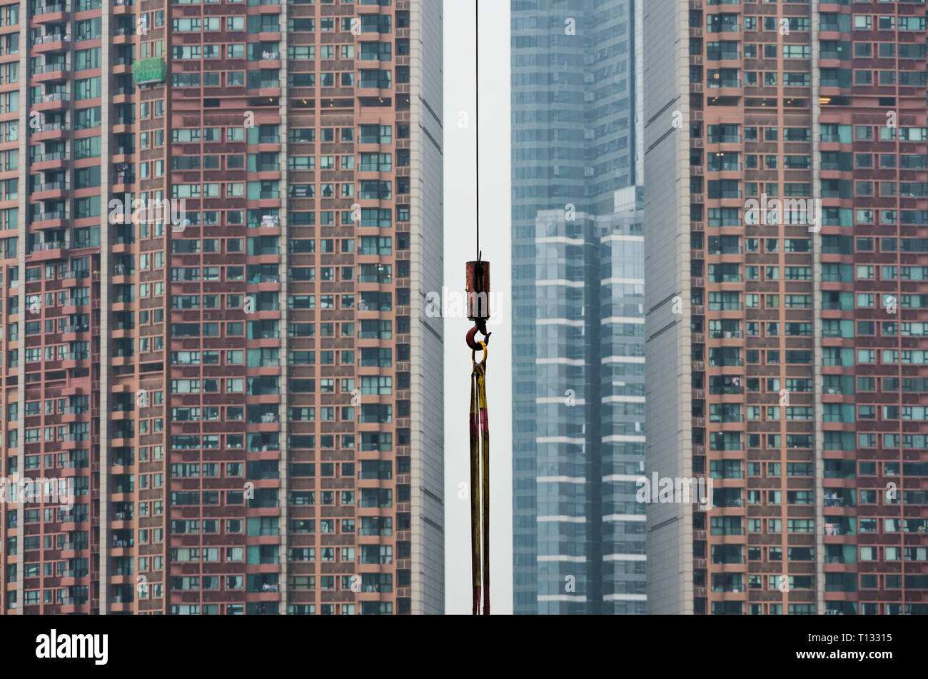 Hong Kong Skyscrapers, Tight space, overpopulation, Construction yard, East Asia, China, Modern buildings, Tower Crane, simple, rope, background, - Stock Image
