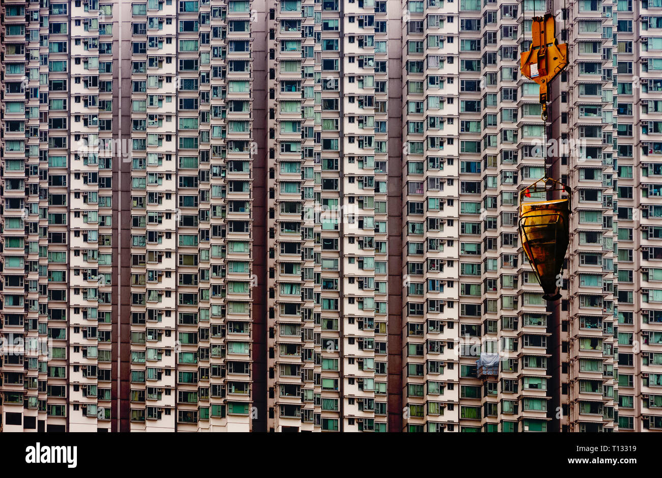 Hong Kong Skyscrapers, Tight space, overpopulation, Construction yard, Modern buildings, Tower Crane, simple, concrete bucket - Stock Image