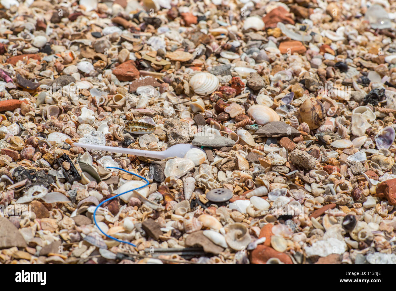 Close up of plastic waste on a beach. - Stock Image