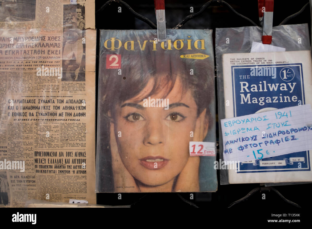 A variety of old Greek magazines, periodicals for sale at a flea market in Thessaloniki, Greece. - Stock Image