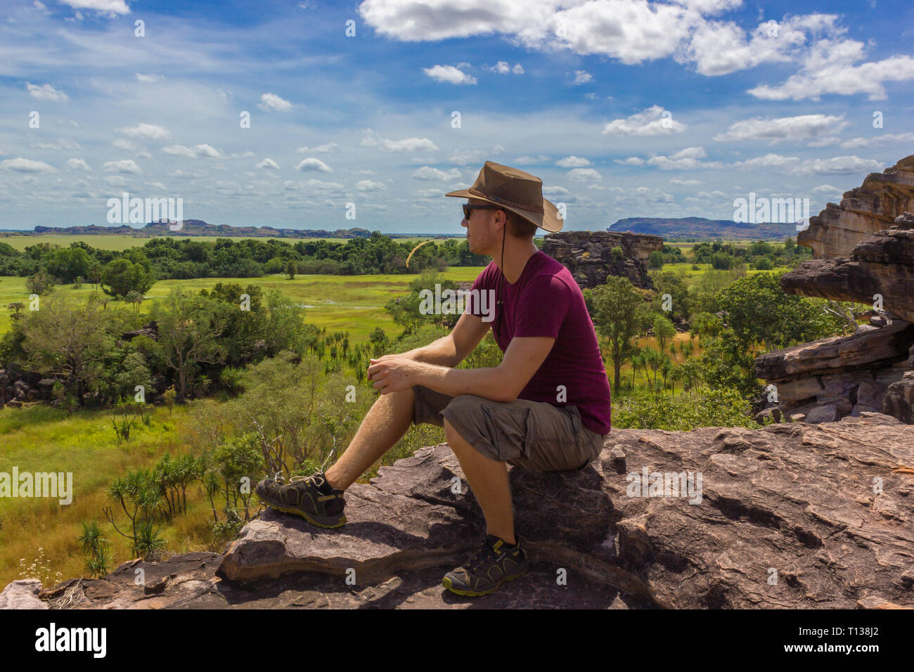 young man enyoing view from the Nadab Lookout in ubirr, kakadu national park Stock Photo