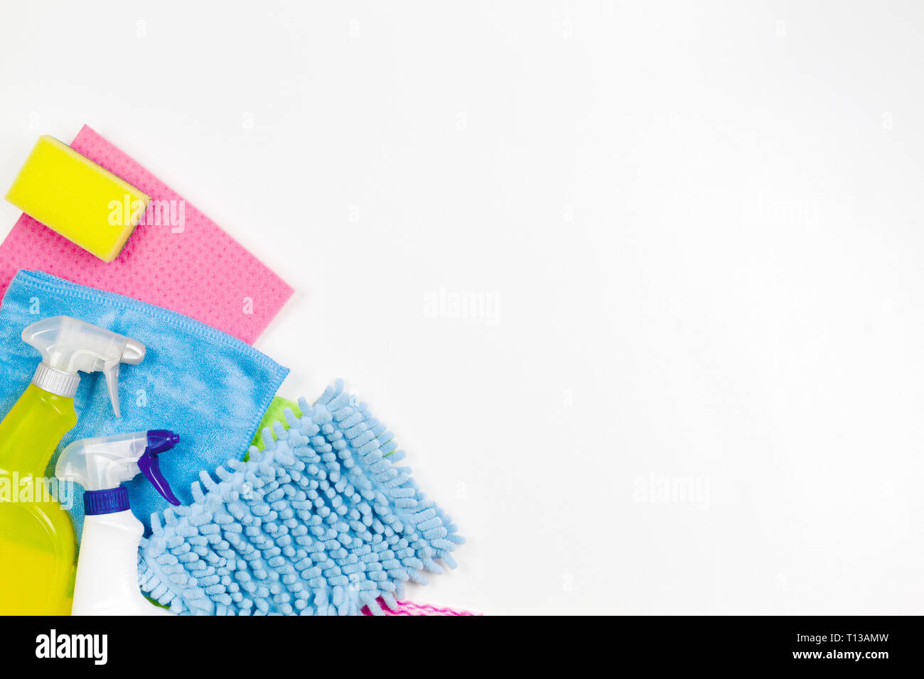 Housework, housekeeping, household, cleaning service concept. Bottles of detergent, rags and sponges on white background - Stock Image