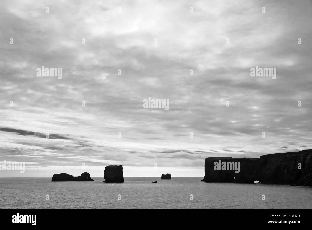 Rock arch at Dyrholaey, Vik, Iceland - Stock Image