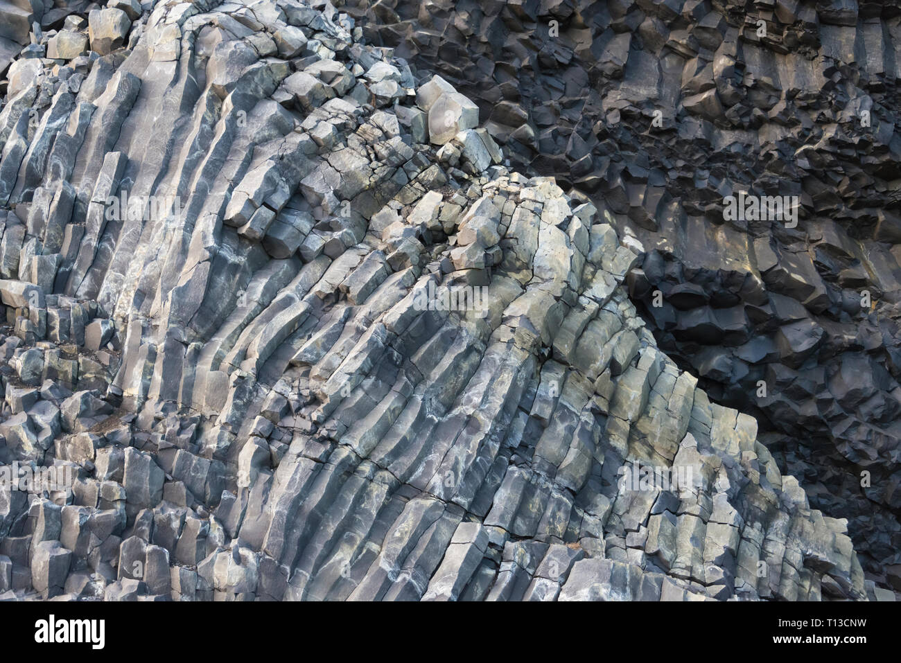 Close-up of basalt rock texture of cave on Black Beach, Reynisfjara, Vik, Iceland - Stock Image