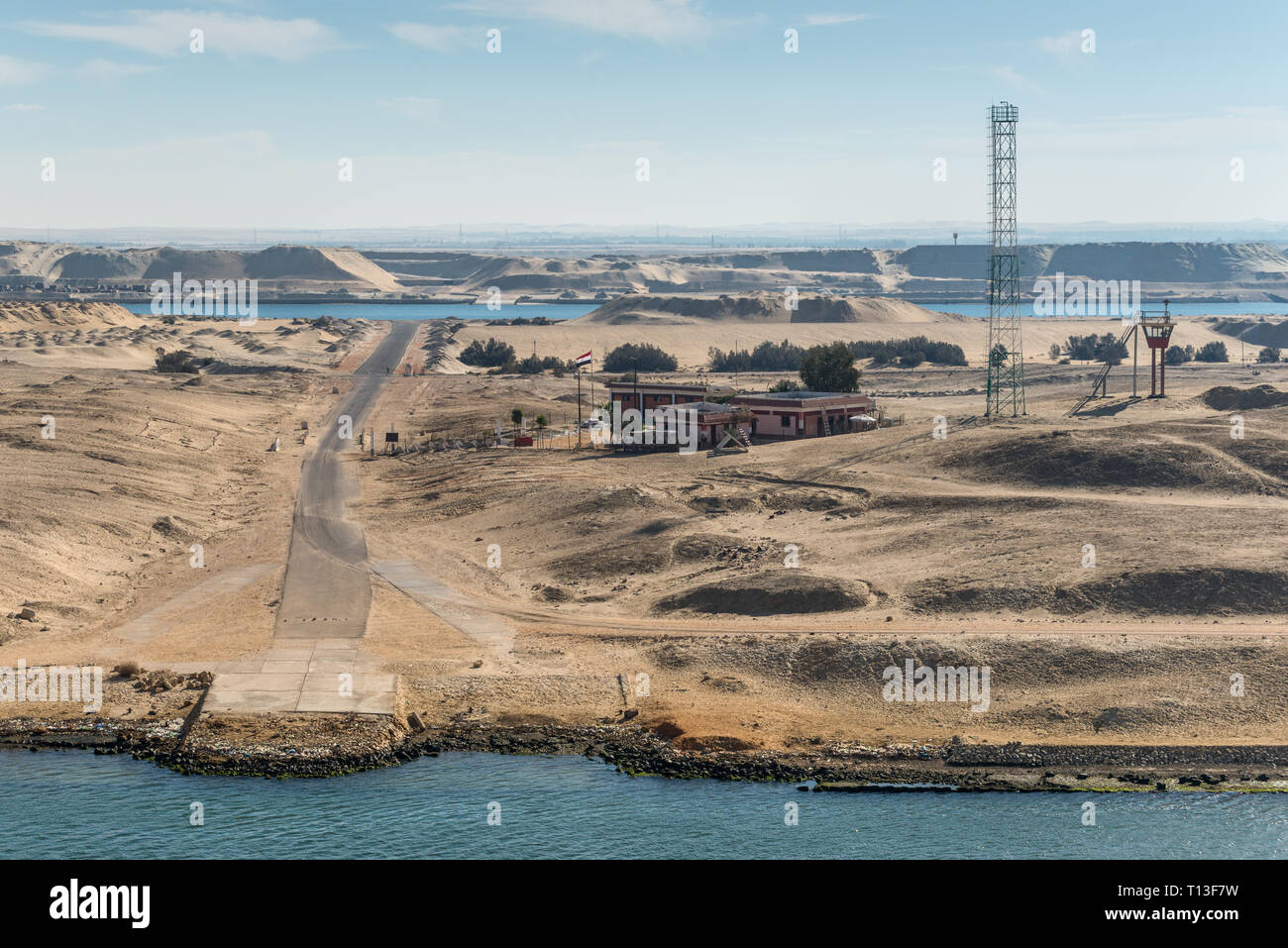 El Ferdan, Egypt - November 5, 2017: Built, communication tower and watch tower on the island in the middle of the Suez Canal near Ismailia, Egypt, Af - Stock Image