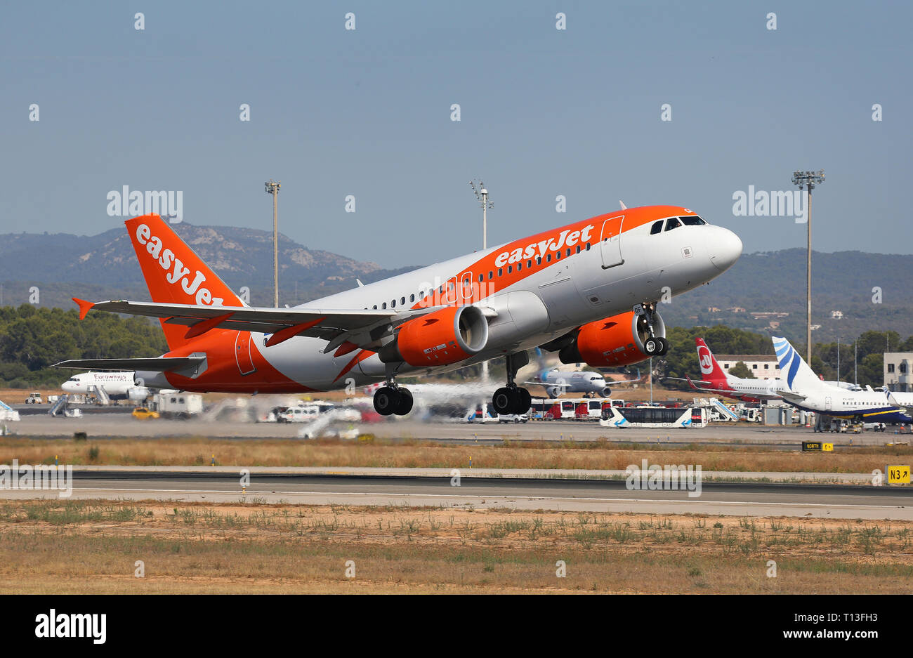 An Easyjet company Airliner taking off from palma de mallorca airport, one of main destinations for european tourists during summer Stock Photo