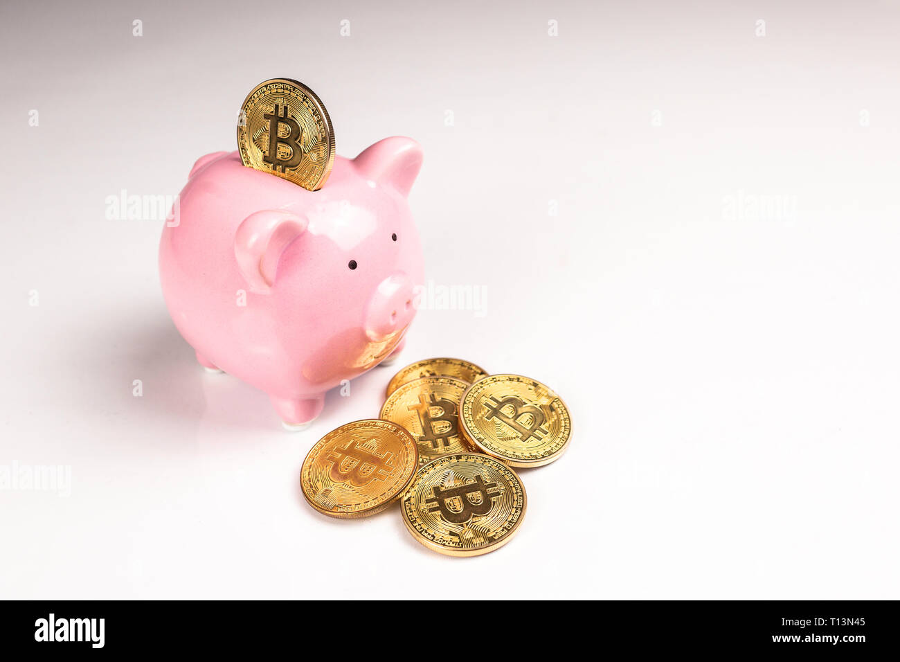 Putting bitcoin to piggy bank, new virtual electronic and digital money, hodl investment concept - Stock Image