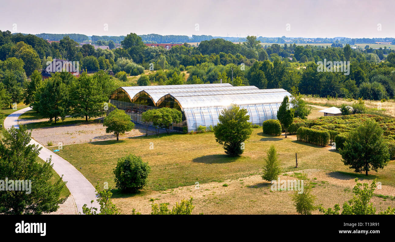 Modern large greenhouses in Wismar. Mecklenburg-Vorpommern, Germany - Stock Image