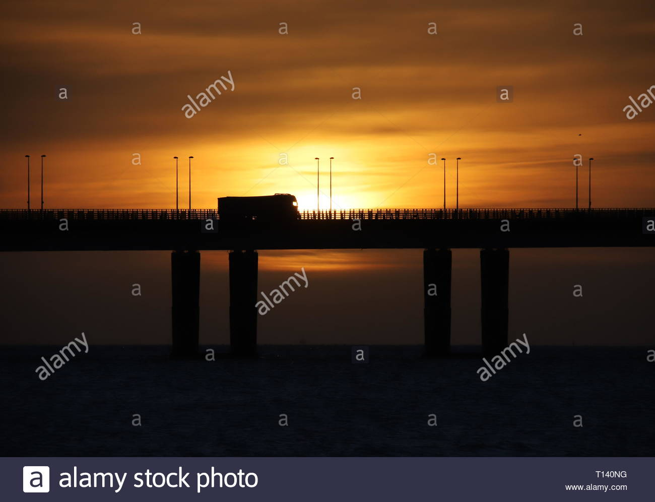 Dundee, UK. 23rd Mar, 2019. Tay Road Bridge at Sunrise, a bright start to a sunny day in Tayside. Credit: Stephen Finn/Alamy Live News - Stock Image