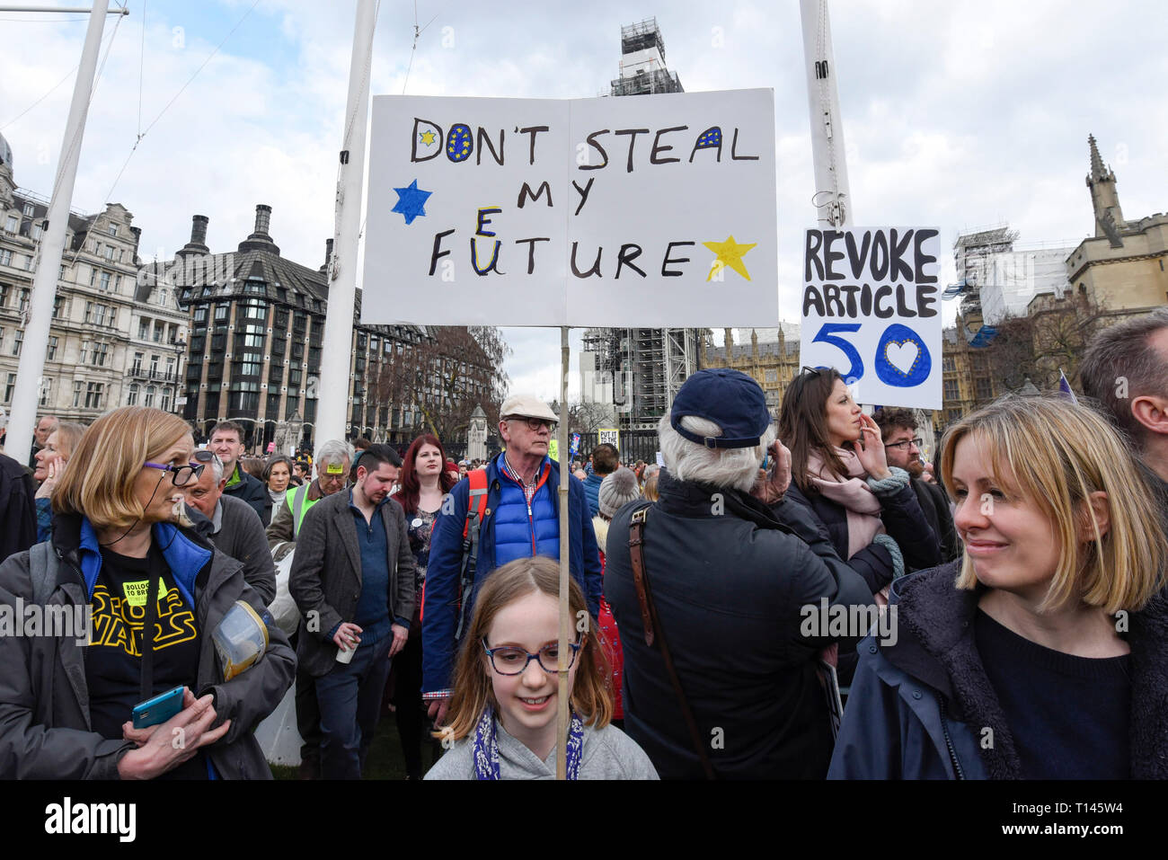 "London, UK.  23 March 2019. Signs held aloft as thousands of people take part in a rally in Parliament Square after the ""Put It To The People March"", on what was supposed to be six days before the UK was due to leave the EU, before an extension to the departure date was given.  Protesters demand that the public is given a final say on Brexit as support for the Prime Minister's withdrawal plan continues to recede.  Credit: Stephen Chung / Alamy Live News Stock Photo"