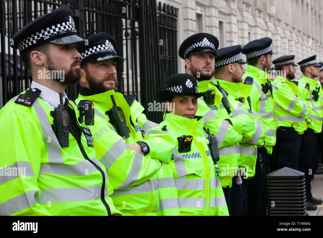 London, UK. 23rd March, 2019. The People's Vote March in London: police guard the gates of Downing Street on Whitehall as protesters passed by, often booing. Credit: Anna Watson/Alamy Live News - Stock Image