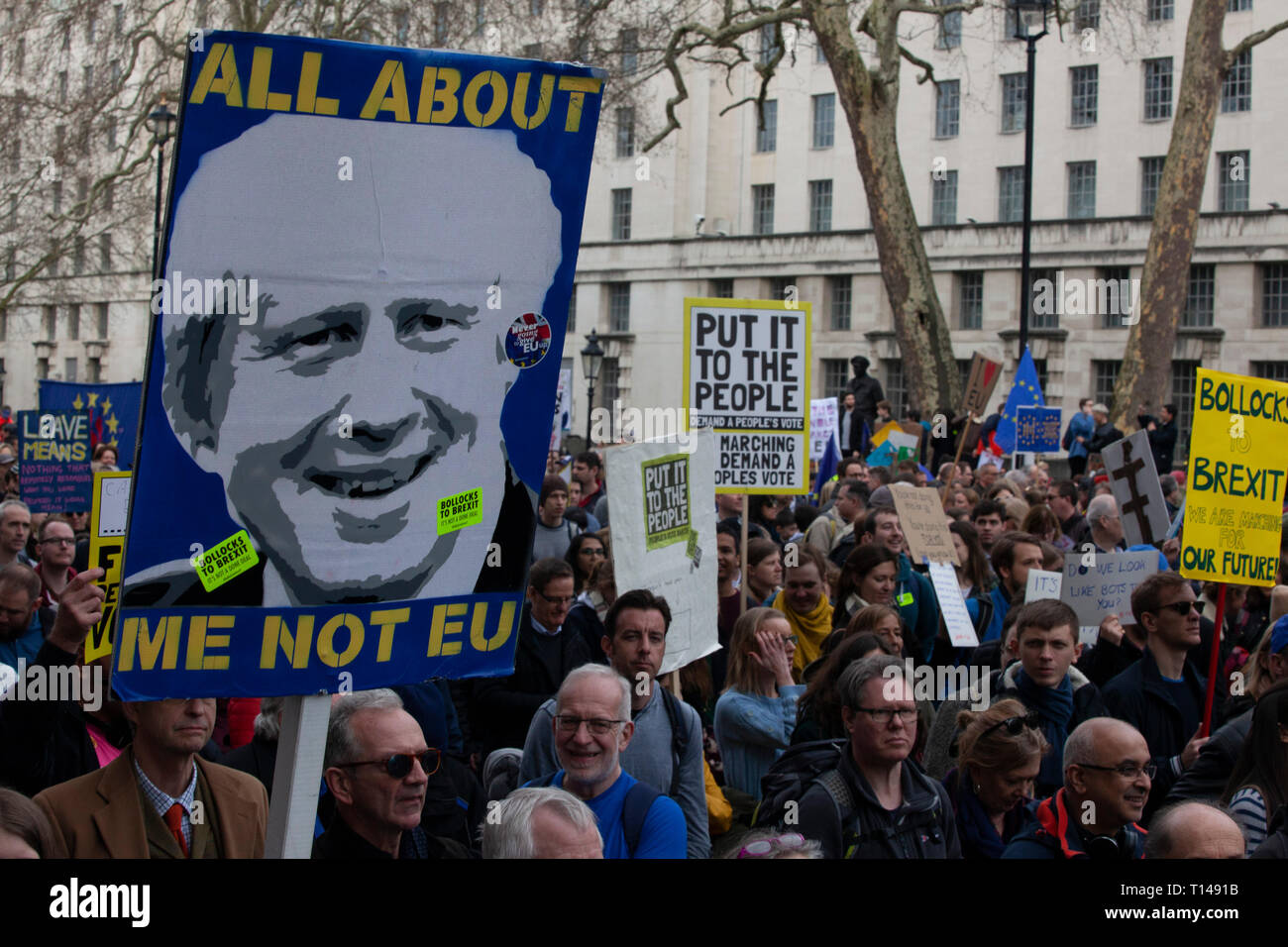 London, UK. 23rd March, 2019.  The Put it to the People March in London: people with home-made placards march past the gates of Downing Street on Whitehall. Credit: Anna Watson/Alamy Live News Stock Photo