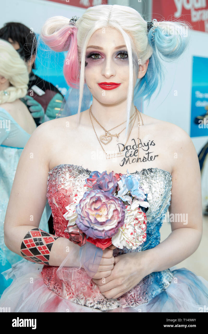 Birmingham, UK. Saturday 23 March 2019. Cosplayers seen as harley quinn character on the 1st day of the MCM Comic Con Birmingham at the NEC  , © Jason Richardson / Alamy Live News - Stock Image