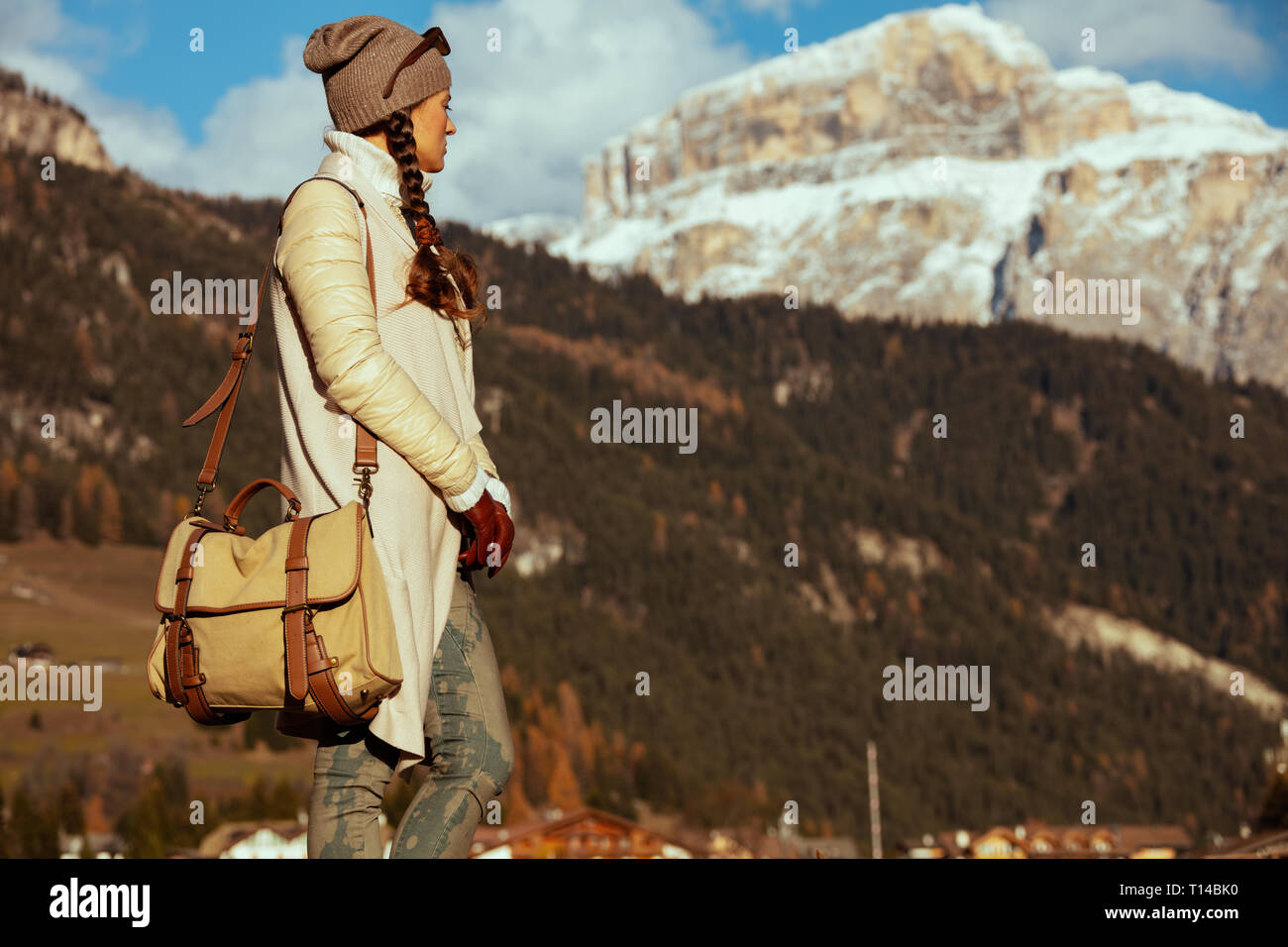 relaxed fit woman hiker in hiking gear with bag in Alto Adige, Italy. - Stock Image