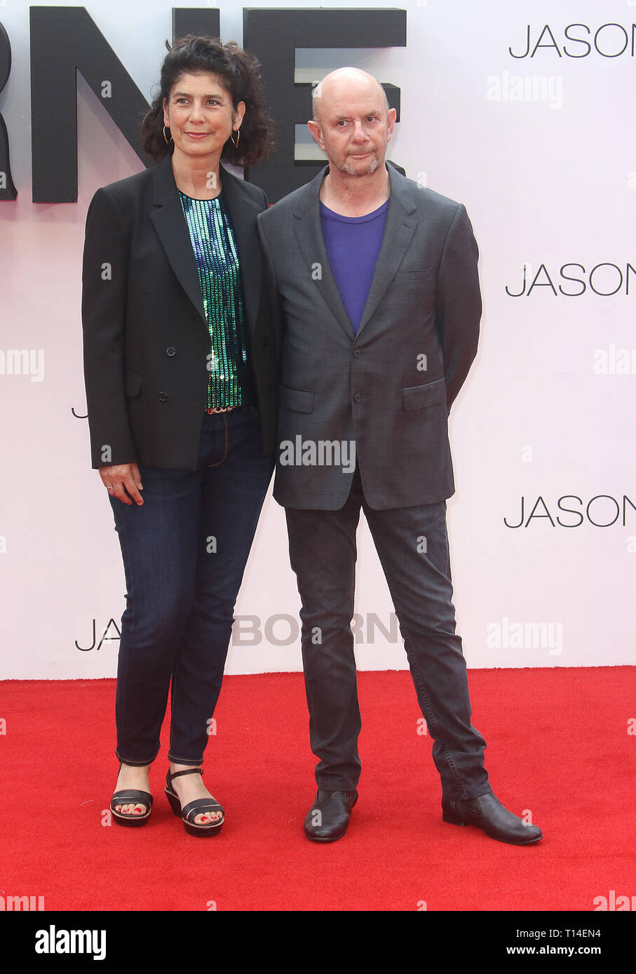 Jul 11, 2016 - London, England, UK - 'Jason Bourne' European Premiere, Odeon Leicester Square - Red Carpet Arrivals Photo Shows: Amanda Posey and Nick - Stock Image