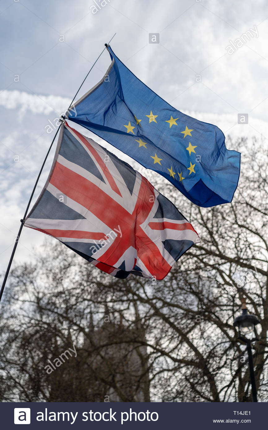 European flag and Union Jack flag together on brexit protest March 23 21019 - Stock Image