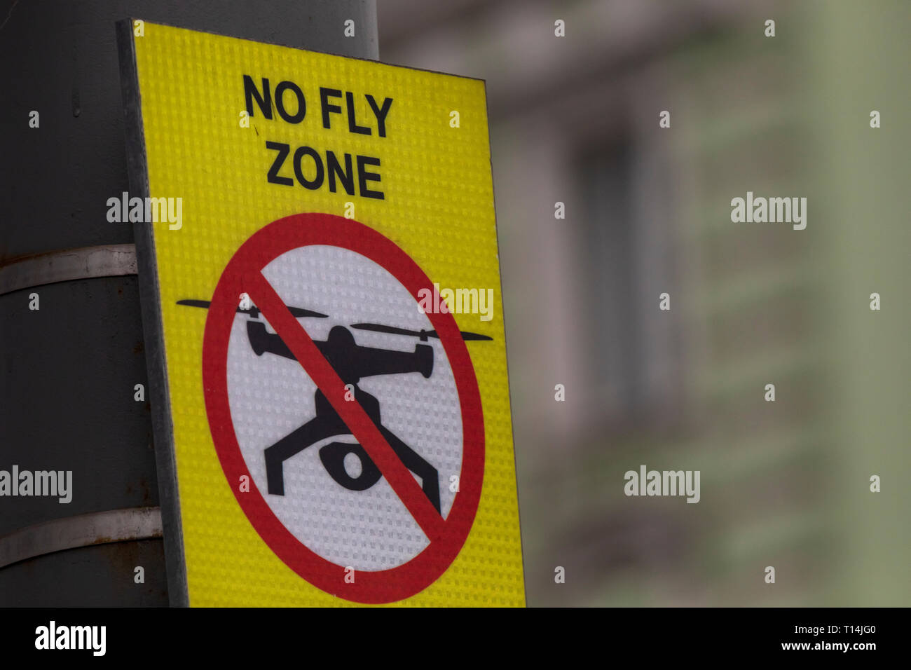 The sign 'No fly zone' prohibiting flights of light aircraft is installed in a center of a city - Stock Image