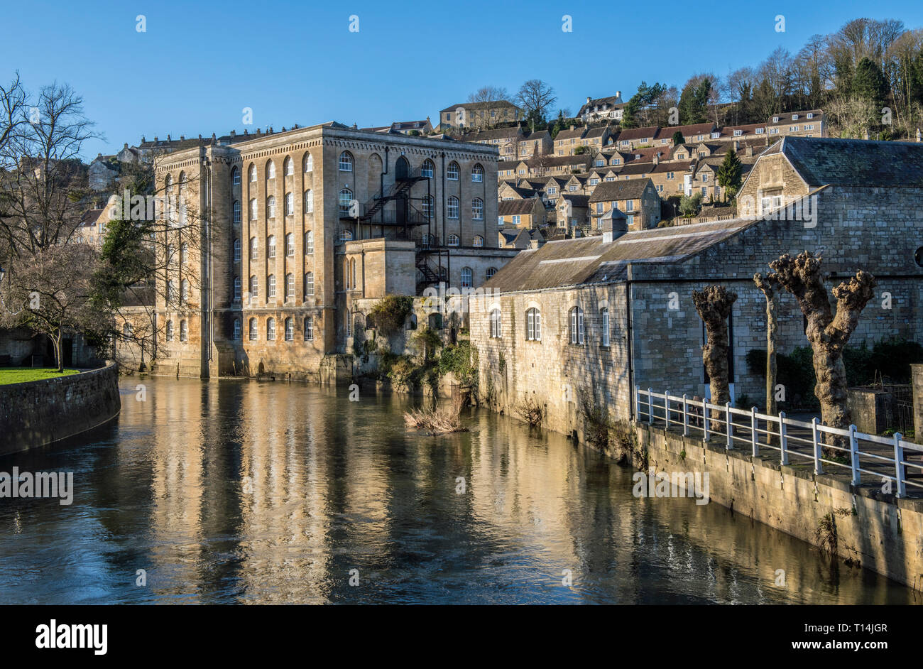 The Old Mill, now apartments, on the side of the River Avon at Bradford on Avon in West Wiltshire. Bradford on Avon grew rich from the wool trade. - Stock Image