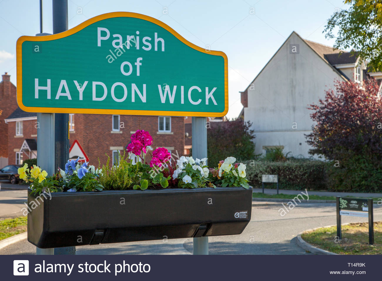 'window box' with flowers, underneath a Parish of Haydon Wick sign, in Tadpole Garden Village, Swindon, England, UK - Stock Image