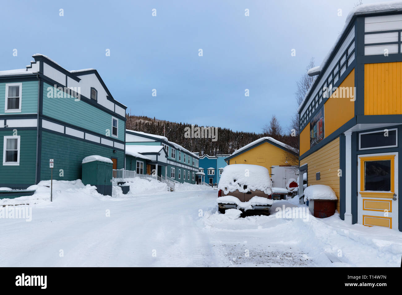 DAWSON CITY, YUKON, CANADA, March 11, 2019 : A snowy street. Dawson City is linked to the Klondike Gold Rush and featured prominently in the novels of - Stock Image
