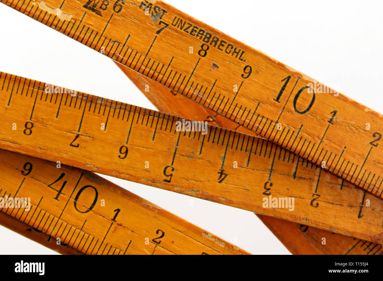 Vintage wooden folding ruler isolated on a white background.isolated on white background, close-up - Stock Image