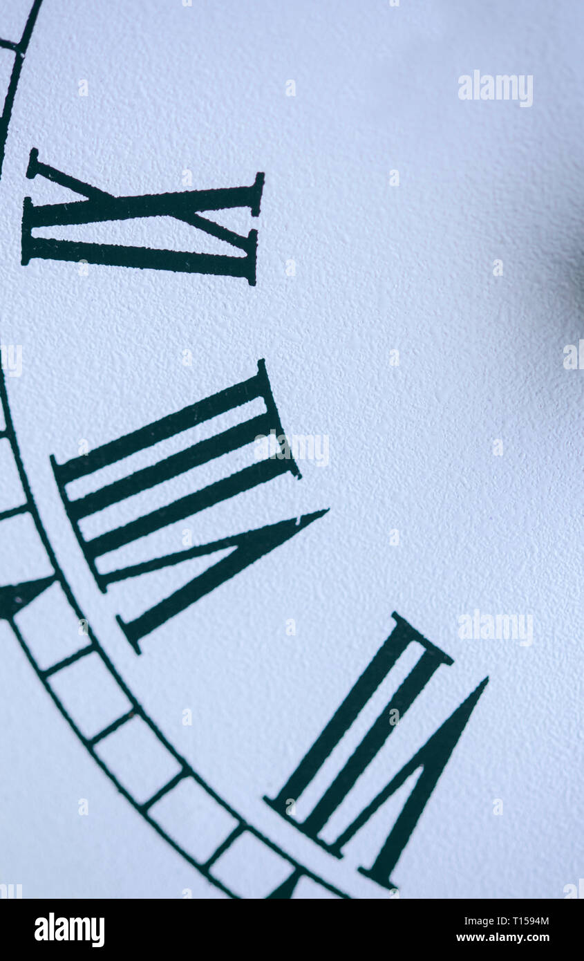 Detail of Roman numerals on a clock face - Stock Image