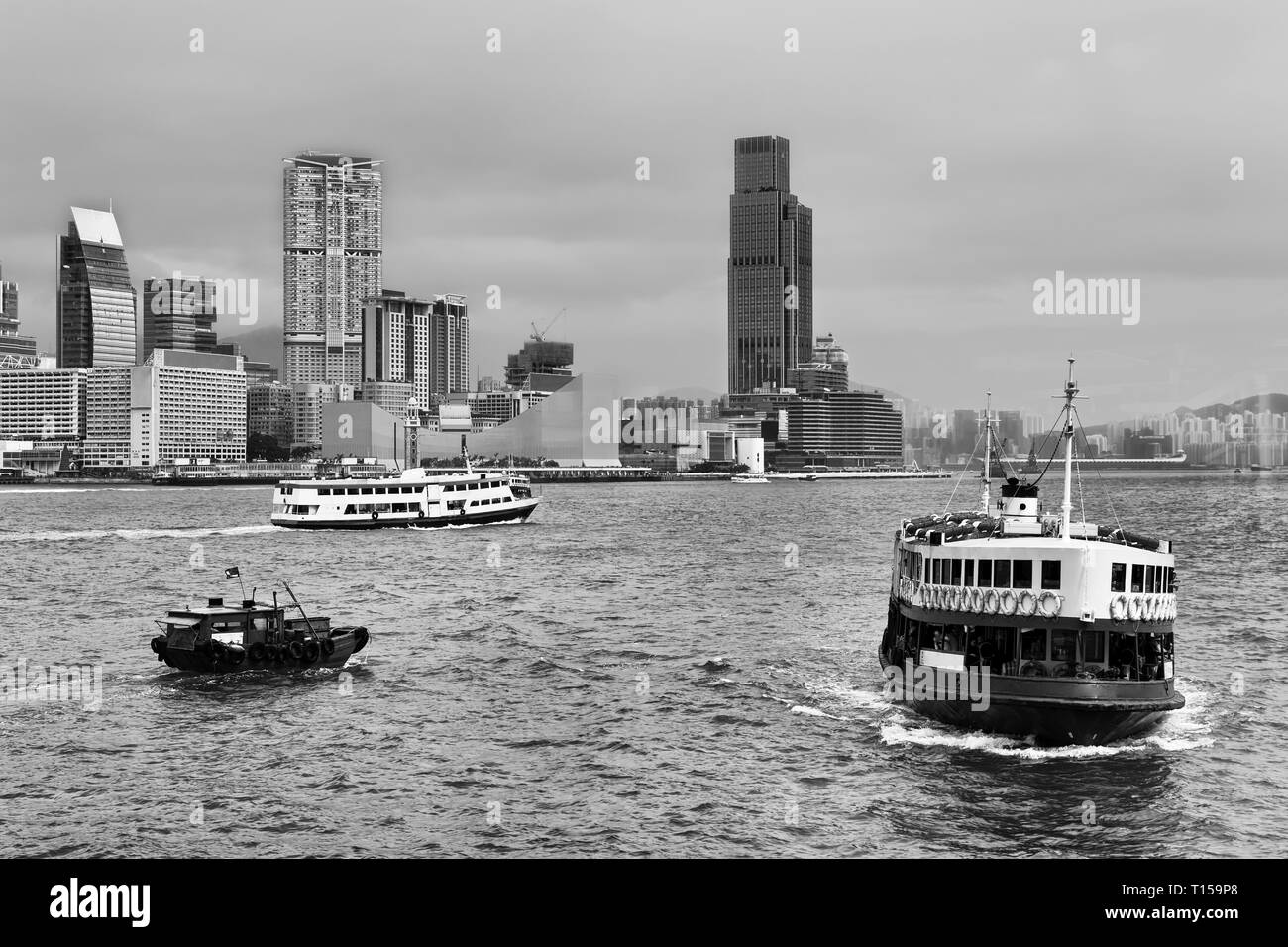 Passenger ferry connecting Hong Kong island with Kowloon and Thim Sha Tsui mainland shores across Victoria Harbour in Honk Kong city. - Stock Image