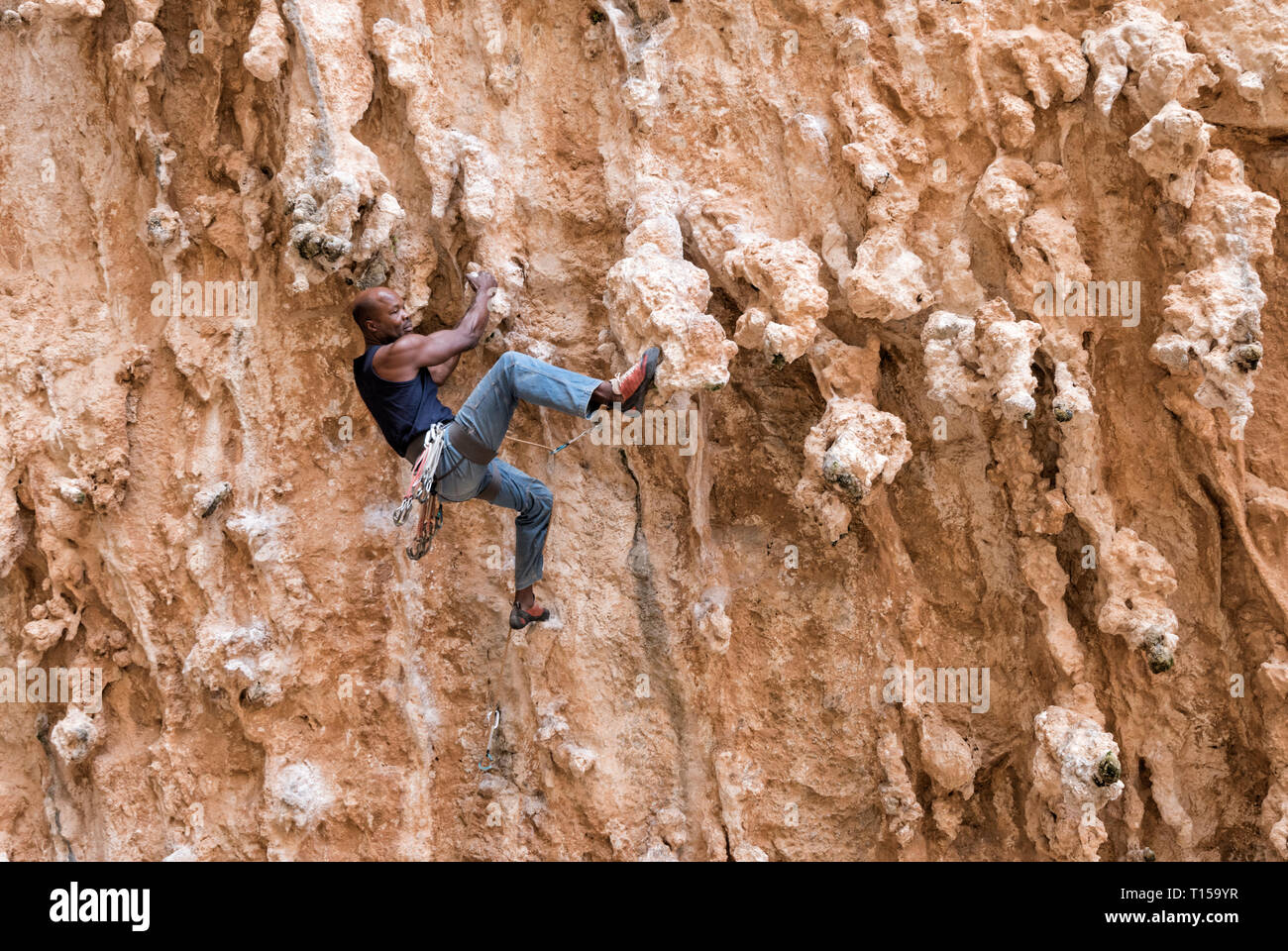 Greece, Kalymnos, climber in rock wall - Stock Image