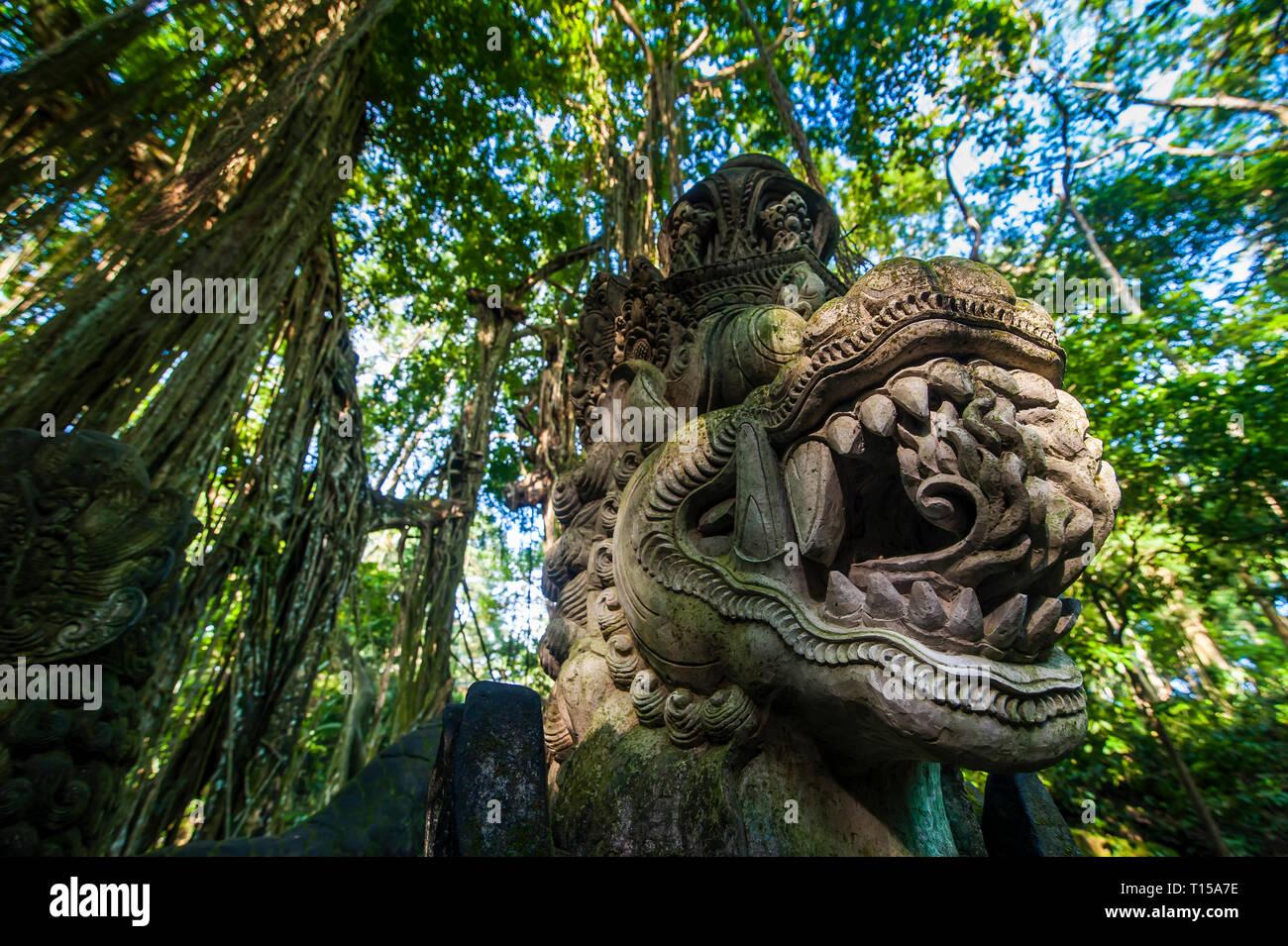 Indonesia, Bali, Ubud Monkey Forest, Stone statue of dragon - Stock Image