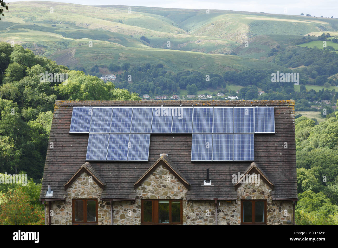 Shropshire, UK - September 10, 2013. Solar panels fitted to the roof of a house in rural England. - Stock Image