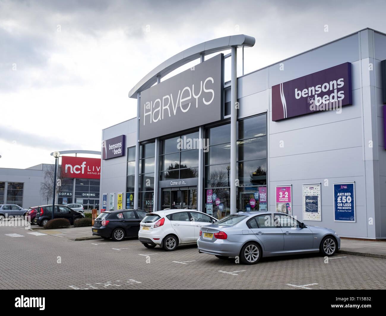 Milton Keynes, UK - February 11, 2019. Exterior of a Harveys furniture store on a retail park. - Stock Image