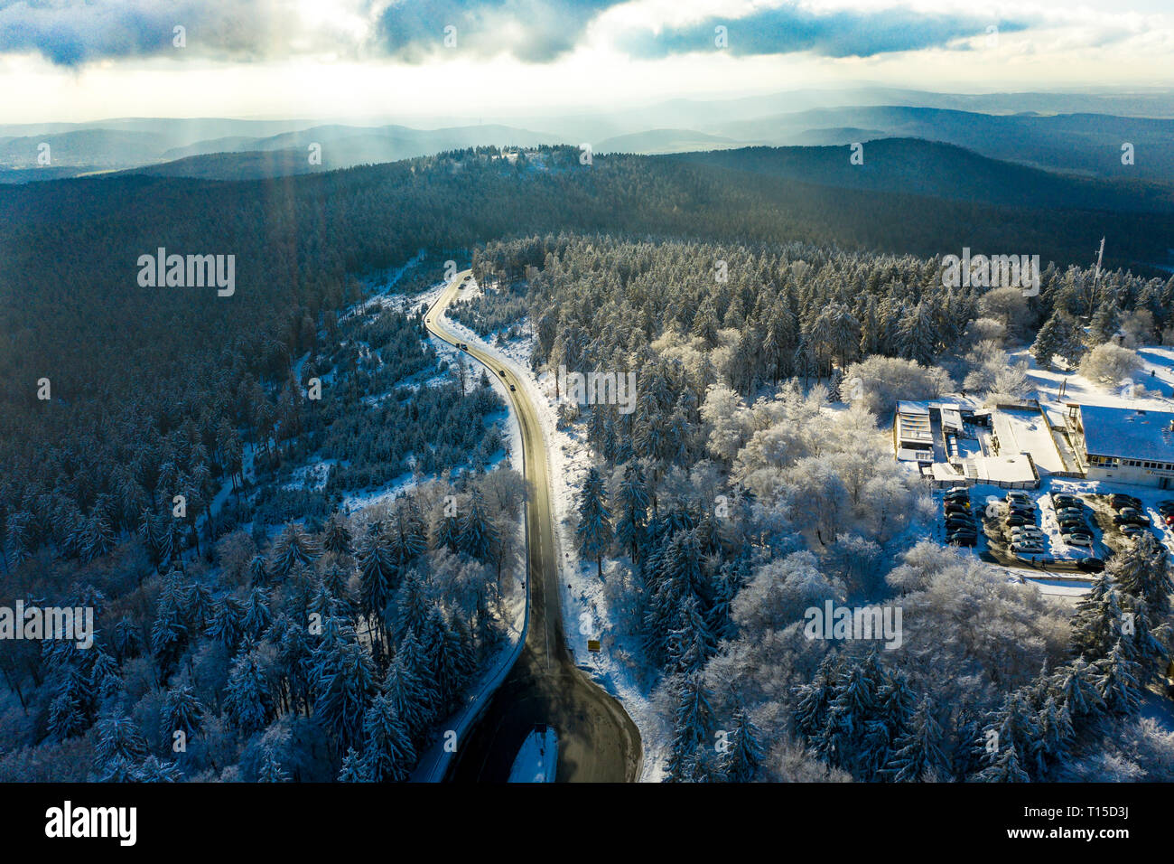 Germany, Hesse, Schmitten, Aerial view of Grosser Feldberg, road and forest in winter Stock Photo