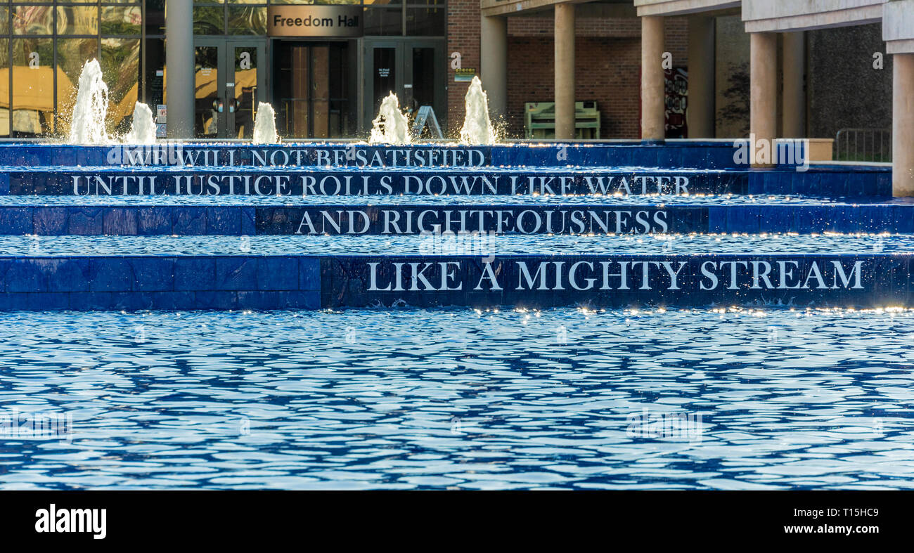 Reflecting pool with quote by Martin Luther King, Jr. at The King Center, site of the Martin Luther King and Coretta Scott King tomb in Atlanta, GA. - Stock Image