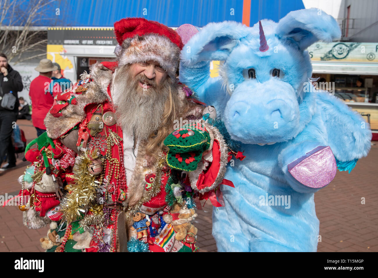 Birmingham, UK. Saturday 23 March 2019. Cosplayers seen in character as  Very Bad Santa and unicorn named Happy from the  Netflix hit Happy on the 1st day of the MCM Comic Con Birmingham at the NEC  , © Jason Richardson / Alamy Live News - Stock Image