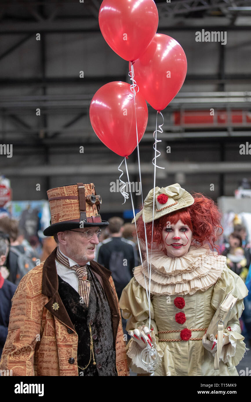 Birmingham, UK. Saturday 23 March 2019. Cosplayers seen in character as an female pennywise on the 1st day of the MCM Comic Con Birmingham at the NEC  , © Jason Richardson / Alamy Live News - Stock Image