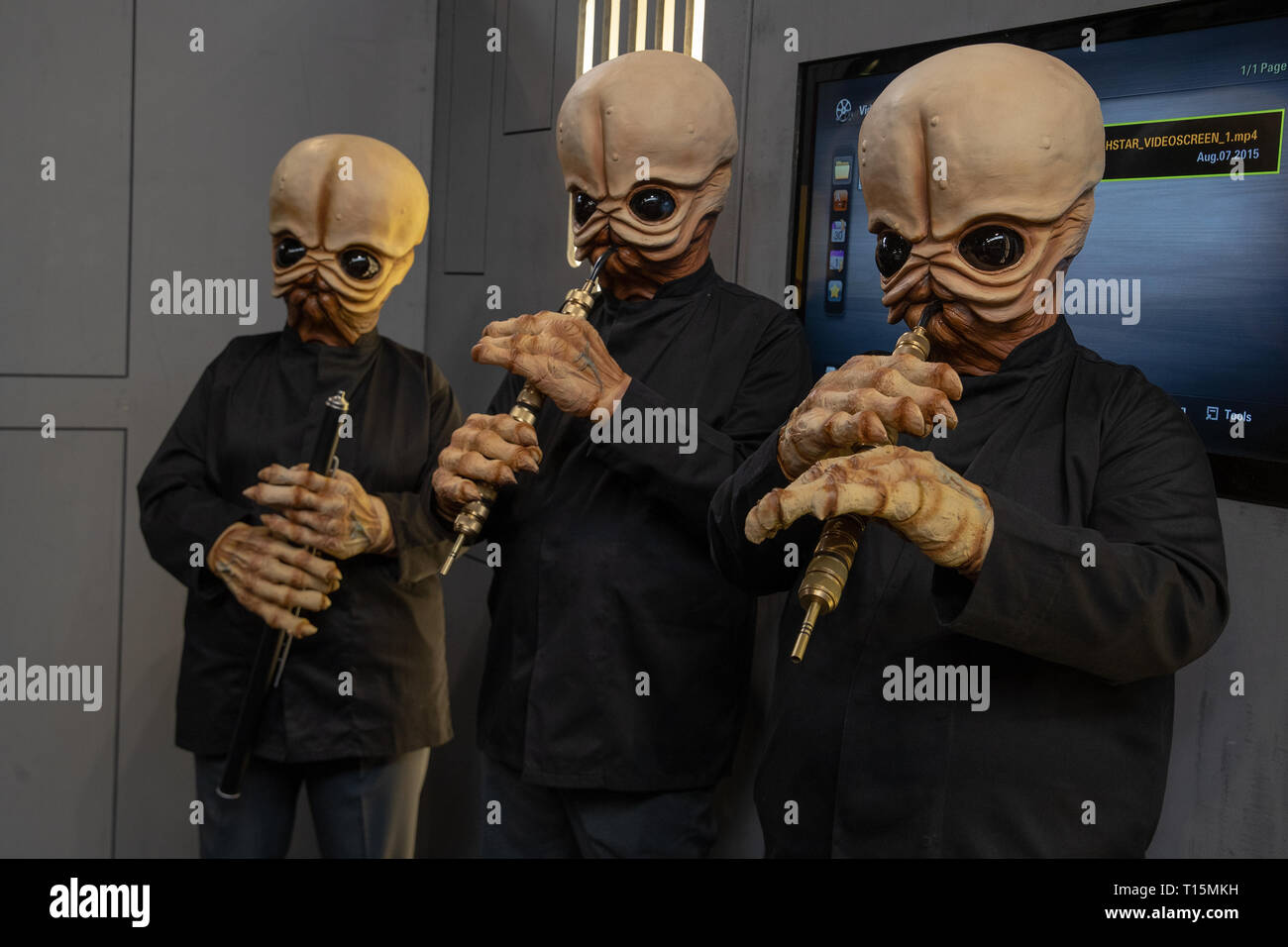 Birmingham, UK. Saturday 23 March 2019. Cosplayers performing as Figrin D'an and the Modal Nodes character from Star Wars: Episode IV A New Hope, on the 1st day of the MCM Comic Con Birmingham at the NEC  , © Jason Richardson / Alamy Live News - Stock Image