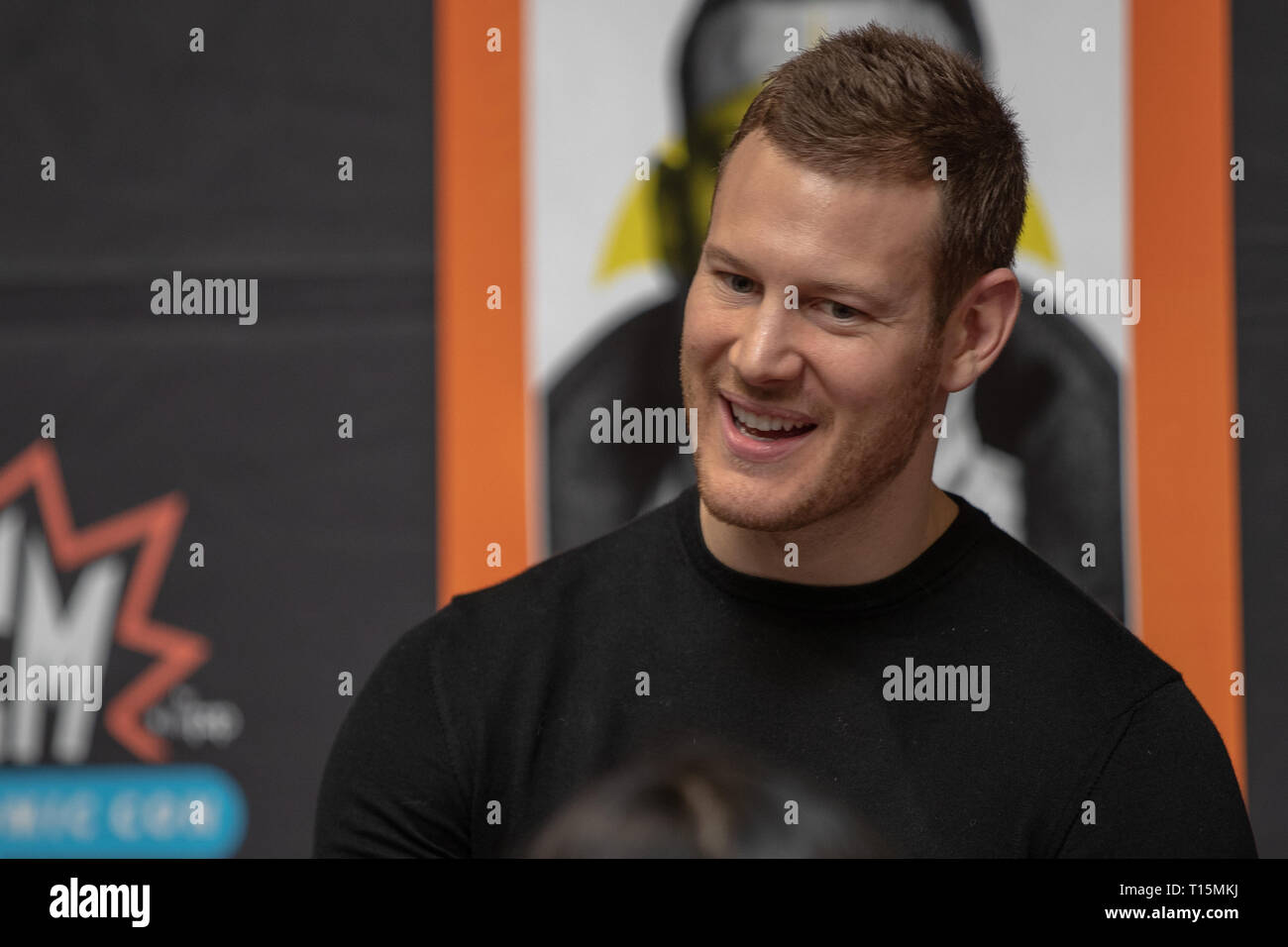 Birmingham, UK. Saturday 23 March 2019.Tom Hopper from The Umbrella Academy during an autograph session, on the 1st day of the MCM Comic Con Birmingham at the NEC  , © Jason Richardson / Alamy Live News - Stock Image
