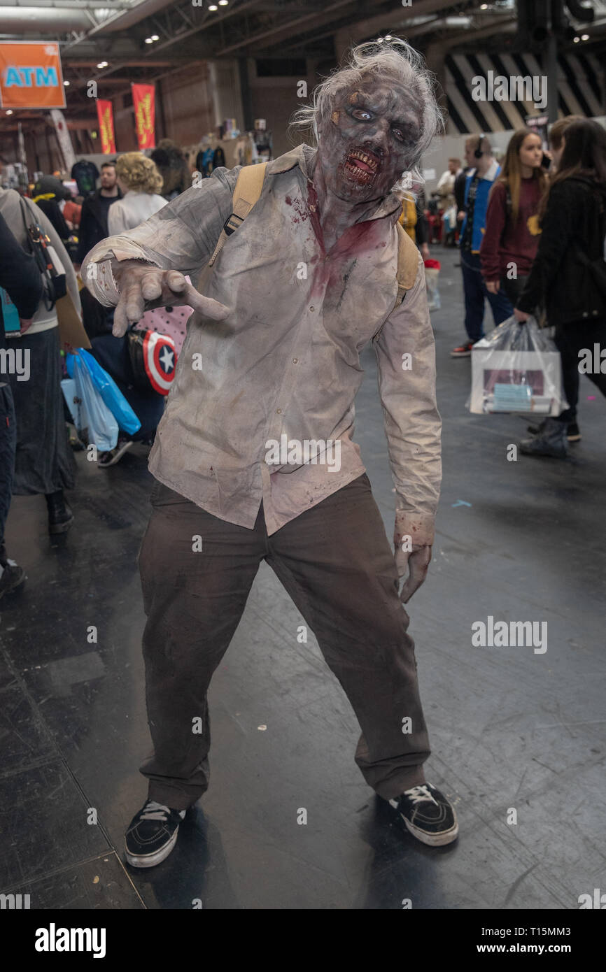 Birmingham, UK. Saturday 23 March 2019. Cosplayers seen in as a zombi character on the 1st day of the MCM Comic Con Birmingham at the NEC  , © Jason Richardson / Alamy Live News - Stock Image