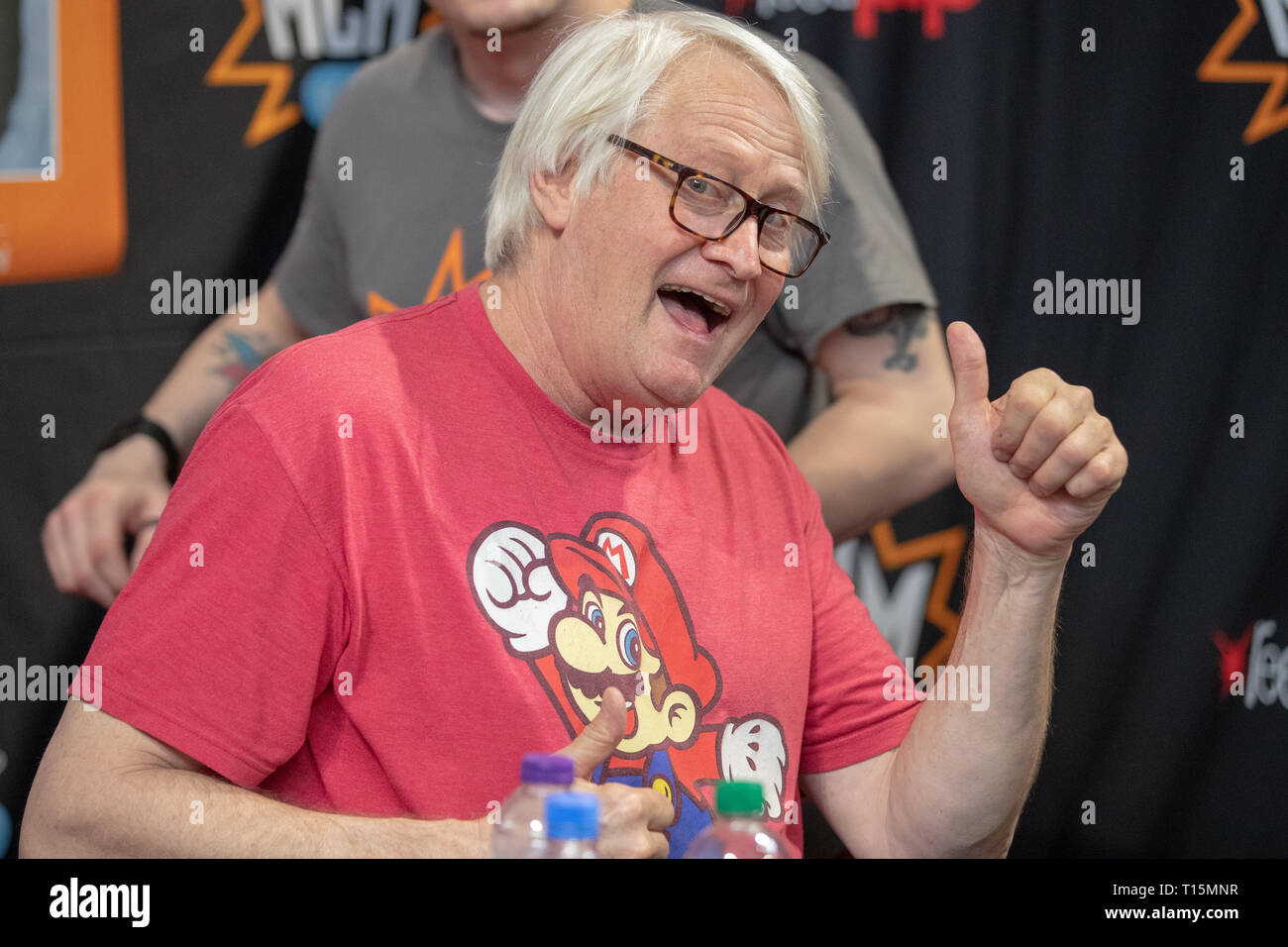 Birmingham, UK. Saturday 23 March 2019. Charles Martinet during an autograph session He is best known for voicing Mario in the Super Mario video game series, on the 1st day of the MCM Comic Con Birmingham at the NEC  , © Jason Richardson / Alamy Live News - Stock Image