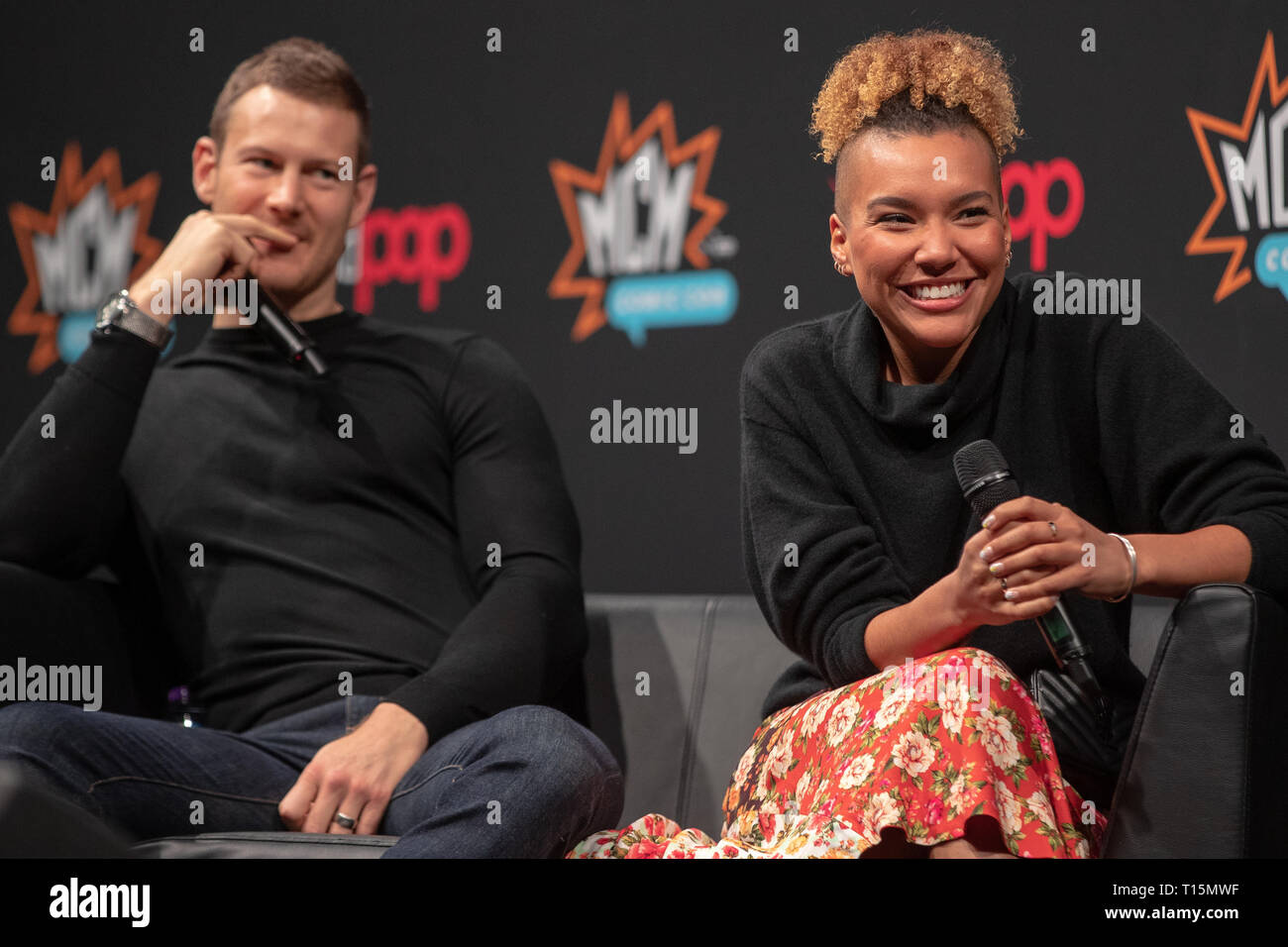 Birmingham, UK. Saturday 23 March 2019. Tom Hopper (L) and Emmy Raver-Lampman (R) discussing the netflix smash hit The Umbrella Academy on the 1st day of the MCM Comic Con Birmingham at the NEC  , © Jason Richardson / Alamy Live News - Stock Image
