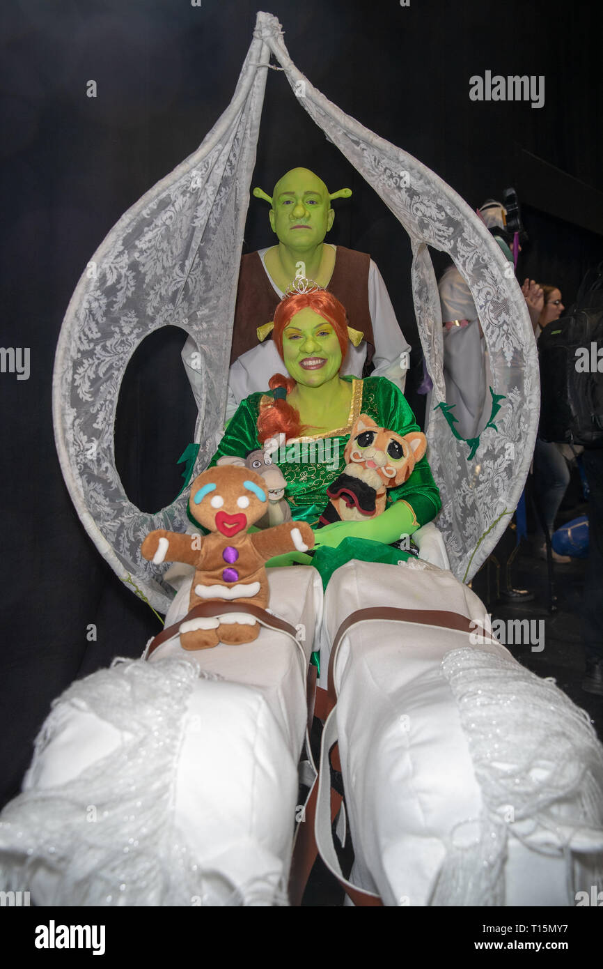 Birmingham, UK. Saturday 23 March 2019. Cosplayers seen in character as Shrek and Fiona on the 1st day of the MCM Comic Con Birmingham at the NEC  , © Jason Richardson / Alamy Live News - Stock Image