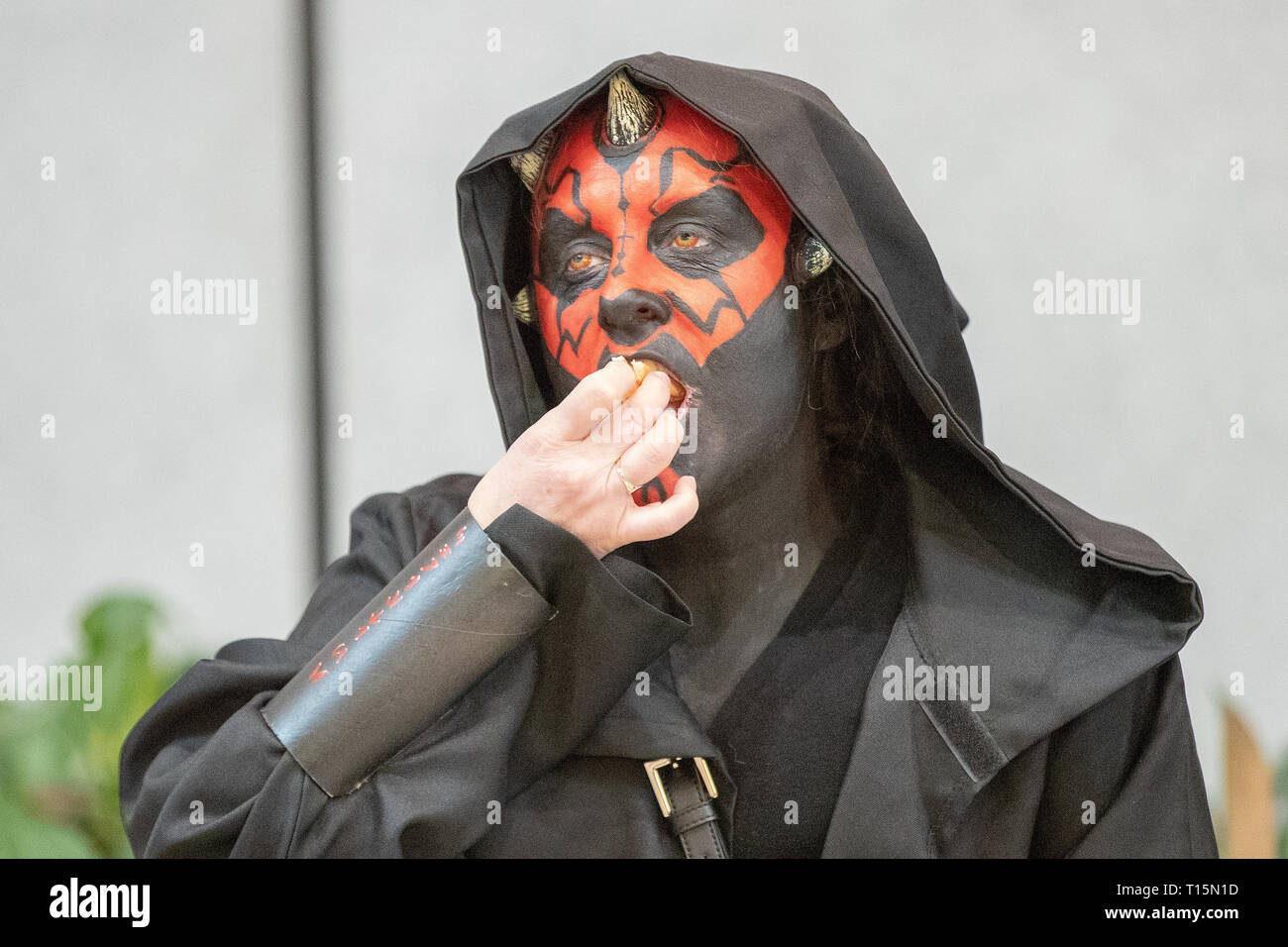 Birmingham, UK. Saturday 23 March 2019. Darth Maul Cosplayers seen eating a burger in character on the 1st day of the MCM Comic Con Birmingham at the NEC  , © Jason Richardson / Alamy Live News - Stock Image