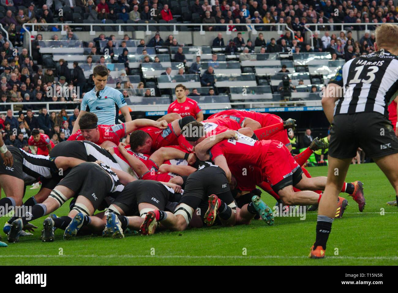 Newcastle upon Tyne, England, 23 March 2019. A scrum collapsing during the Gallagher Premiership match between Newcastle Falcons and Sale Sharks at St James Park, Newcastle. Credit: Colin Edwards/Alamy Live News. - Stock Image