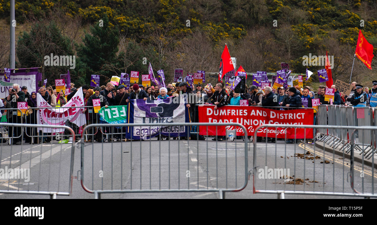 Edinburgh, Scotland, UK. 23rd Mar, 2019. March to the Scottish Parliament in Edinburgh by far-right Scottish Defence League (SDL) was met by a counter demonstration by several left wing groups such as Unite Against Fascism, Muslin Women's Association and Edinburgh Antifa. A heavy police presence was in force and the SDL were closely escorted to and from Waverley Station. Pictured; counter demonstration by anti racist protestors Credit: Iain Masterton/Alamy Live News - Stock Image