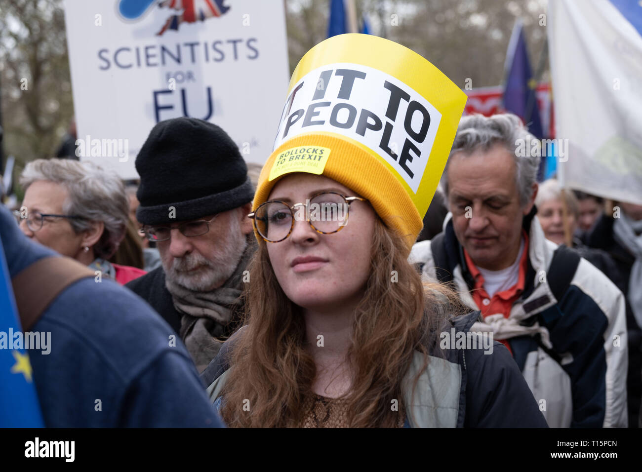 London, UK. 23rd Mar, 2019. Woman in crowd wearing Put it to the People yellow hat at protest march. London 23 March 2019 Credit: Chris Moos/Alamy Live News Stock Photo