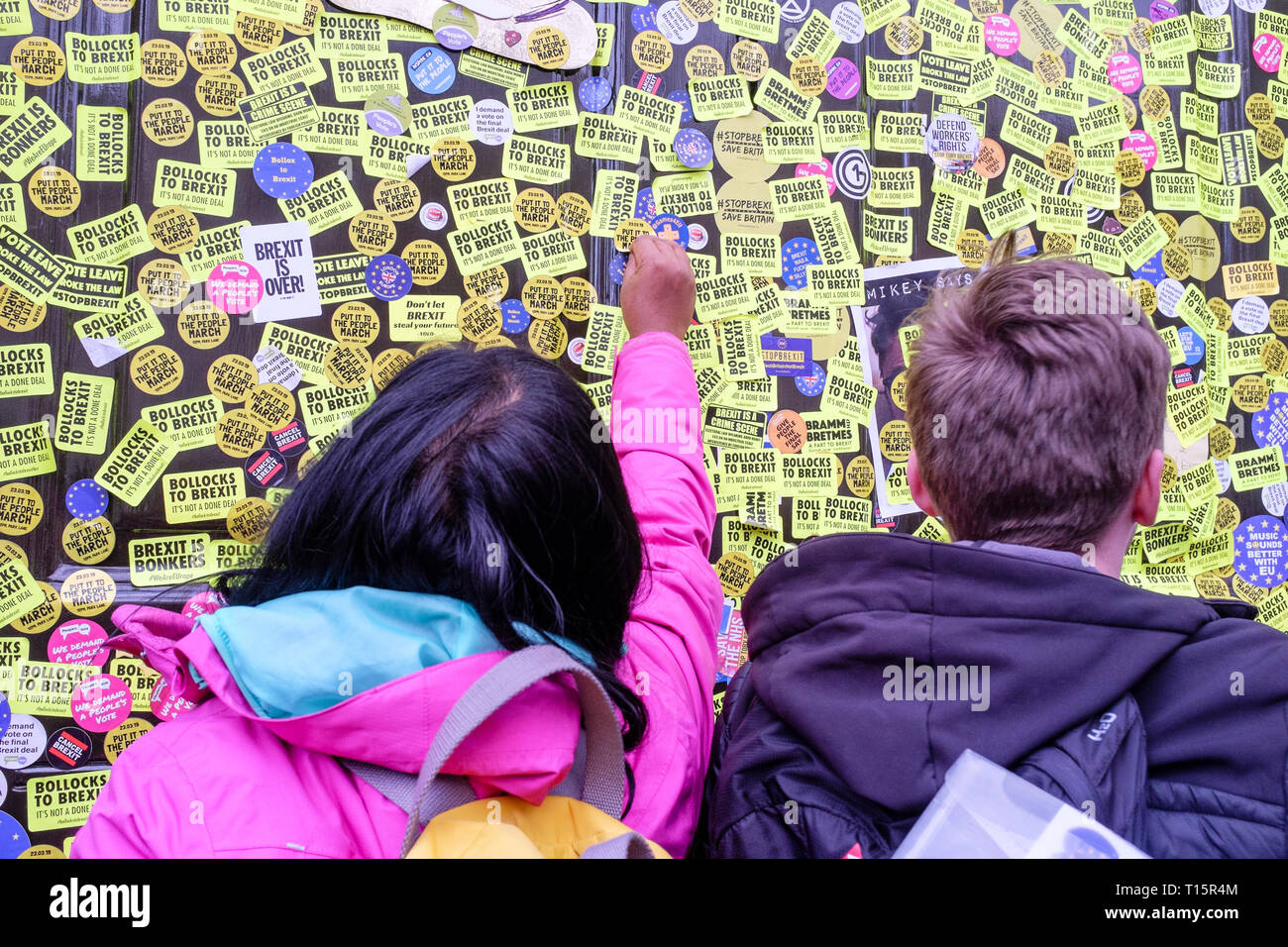 London, UK. 23rd March 2019. Hundreds of thousands of people march through central London demanding a second vote on the UK's membership of the European Union. Pictured: Pro EU Remainers post hundreds of anti-Brexit stickers on doors of the UK Government Cabinet Office building in Whitehall. Credit: mark phillips/Alamy Live News - Stock Image